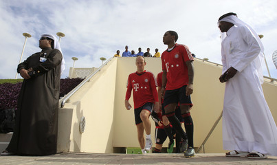 Bayern Munich's Robben and Braafheid arrive for a training session at Aspire Academy for Sports Excellence in Doha