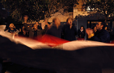 Protesters celebrate in front of the Egyptian embassy after the announcement of Egyptian President Hosni Mubarak's resignation in Amman