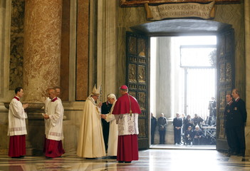 Pope Francis meets Emeritus Pope Benedict XVI after opening the Holy Door to mark opening of the Catholic Holy Year, or Jubilee, in St. Peter's Basilica, at the Vatican
