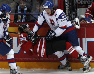 Canada's Benn collides with the Slovakia's Hascak and Bartovic during their 2012 IIHF ice hockey World Championship Group H game in Helsinki