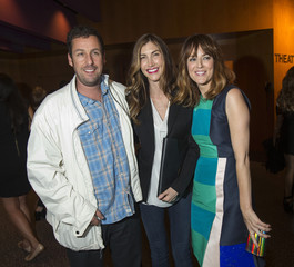 """Cast member Sandler and his wife Jackie pose with co-star DeWitt at the party following the premiere of """"Men, Women & Children"""" at the Directors Guild of America in Los Angeles"""