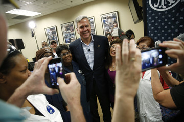 Bush poses with workers after a town hall meeting with employees at FN America gun manufacturers in Columbia, South Carolina