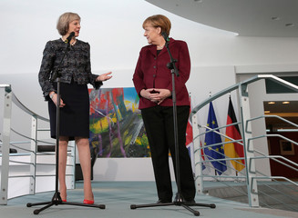 German Chancellor Merkel and Britain's Prime Minister May address the media prior to a meeting at the chancellery in Berlin