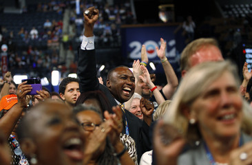 Delegates react during first day of the Democratic National Convention in Charlotte