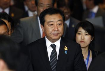Japan's Prime Minister Yoshihiko Noda walks after attending the ASEAN-Japan Commemorative Summit in Bali