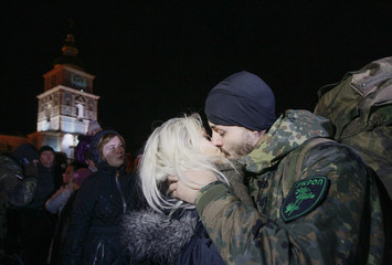 New volunteer for the Ukrainian Interior Ministry's Azov battalion kisses his girlfriend after taking his oath of allegiance to his country in Kiev
