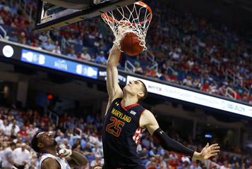 Maryland Terrapins' Len dunks the ball over North Carolina Tar Heels' Hairston during the first half of their ACC Championship college basketball game in Greensboro