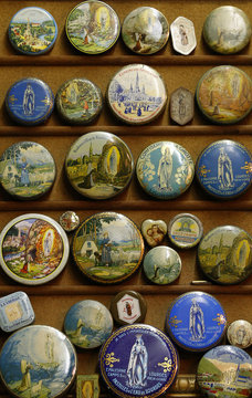 Vintage lithographed tin boxes depicting images of the Virgin Mary are displayed as part of a huge collection at the house of Dardenne in Grand-Hallet