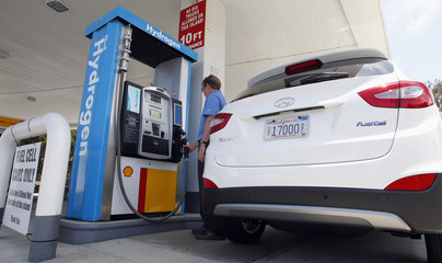 Hyundai Tucson hydrogen fuel cell electric vehicle is filled at pump by Derek Joyce in Newport Beach, California