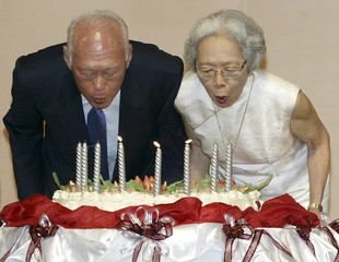 File photo of Lee and his wife blowing a birthday cake as he celebrates his 80th birthday in Singapore