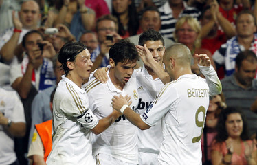 Real Madrid's Kaka celebrates his goal against Ajax Amsterdam with teammates Ozil, Ronaldo and Benzema during their Champions League Group D soccer match in Madrid