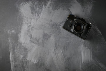 Retro camera on wood table background
