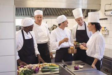 Team of chef tasting food in the commercial kitchen