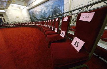 Name cards and numbers are placed on seats before a photo opportunity with U.S. Secretary of State Kerry in Beijing