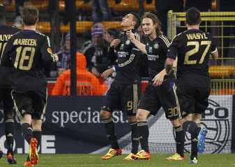 Suarez of Anderlecht and teammates celebrate after scoring against Lokomotiv Moscow during their Europa League soccer match in Brussels