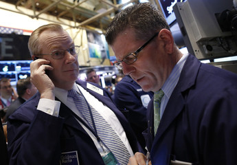 Goldman Sachs traders Maguire and Spain work on the floor at the New York Stock Exchange
