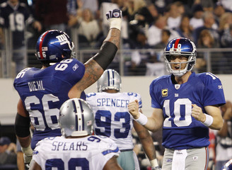 New York quarterback Manning celebrates with guard Diehl after running back Jacobs scored a touchdown against Dallas Cowboys to win the game in Arlington, Texas
