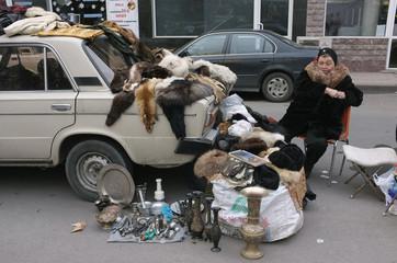 Woman sells goods on a street in Yerevan