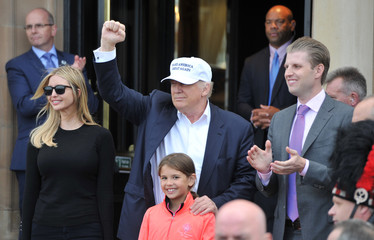 Republican presidential candidate Donald Trump, his son Eric and daughter Ivanka pose for photographs as they arrive at his Turnberry golf course, in Turnberry, Scotland