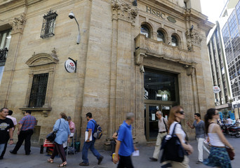 Pedestrians walk past a main branch of HSBC bank in downtown Buenos Aires