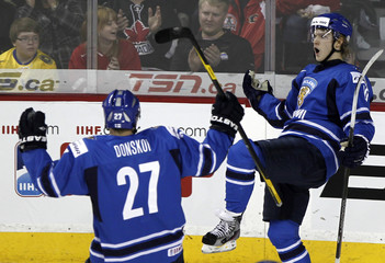 Finland's Armia celebrates his goal against Sweden with teammate Donskoi in the second period of play during the semi-final of the 2012 IIHF U20 World Junior Hockey Championship in Calgary