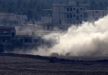 Smoke rises during fighting between the Islamic State and Kurdish forces in an eastern Kobani neighbourhood
