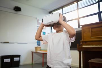 Close of boy holding virtual reality simulator
