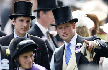 Britain's Prince Harry and Jake Warren stand in the parade ring before The Gold Cup on the third day of the Royal Ascot horse racing festival at Ascot, southern England
