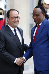 Niger's President Mahamadou Issoufou is greeted by French President Francois Hollande upon his arrival at the Elysee palace in Paris