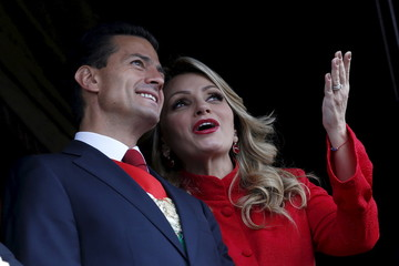 Mexico's President Nieto speaks with First Lady Rivera during a military parade celebrating Independence Day at Zocalo Square in downtown Mexico City