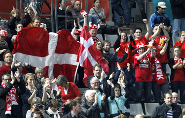 Denmark's supporters celebrate after their team won their World Men's Handball Championship match against Hungary in Barcelona