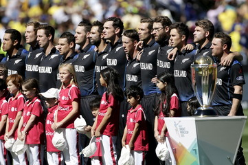 New Zealand's captain Brendon McCullum stands with his team mates during the playing of the national anthems before the start of their Cricket World Cup final match against Australia at the MCG