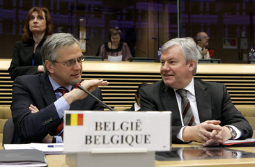 Belgium's Flemish Minister President Peeters and Walloon Minister of Economy Marcourt chat before an informal ministerial meeting on the automotive sector, in Brussels