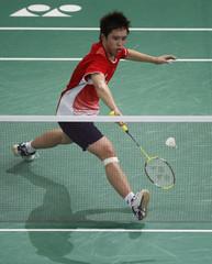 Japan's Kenichi Tago hits a return to Indonesia's Taufik Hidayat during the men's singles quarter-finals of the Malaysian Open Super Series 2011 badminton tournament in Kuala Lumpur
