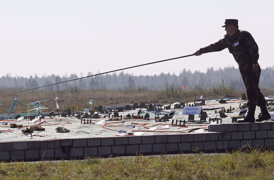 """A Ukrainian officer stands near a large tactical map during """"Perspective 2012"""" military exercise near Zhytomyr"""