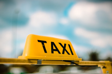 A taxi sign with blurred background