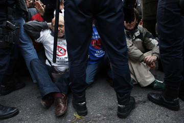 Spanish riot police block demonstrators during a protest in favour of the public health system in Madrid