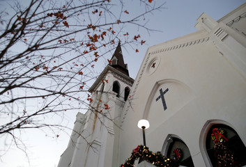Christmas decorations and a small tree frame the Mother Emanuel AME Church after the federal trial of Dylann Roof who was found guilty of 33 counts including hate crimes in Charleston