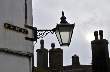 A sign for the High Street shopping district is seen in the centre of Seaford in East Sussex in southern England