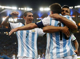 Argentina's Messi is congratulated by his Aguero and Di Maria after scoring a goal against Bosnia during their 2014 World Cup Group F soccer match at the Maracana stadium in Rio de Janeiro