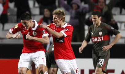 Benfica's Cardozo celebrates his goal against VfB Stuttgart with teammate Coentrao during their Europa League last 32, first leg soccer match at Luz stadium in Lisbon