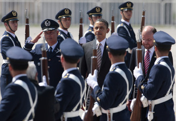 U.S. President Obama is escorted by Chile's Foreign Minister Moreno in Santiago