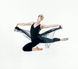 Elegant ballerina jump in ballet hall