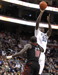 Villanova forward Yarou shoots over Louisville center Dieng during their NCAA basketball game in Philadelphia
