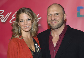 "Annie Stanley and former mixed martial arts champion Randy Couture arrive for the ""Power of Love Gala"" and 70th birthday celebration for Muhammad Ali  in Las Vegas"