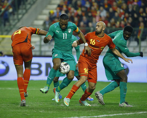 Ivory Coast's Drogba powers his way past Belgium's Kompany and Vanden Borre as Ivory Coast'sToure looks on before scoring a goal during their international friendly soccer match at King Baudouin Stadium in Brussels