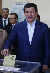 Turkish Prime Minister Ahmet Davutoglu casts his ballot at a polling station during the parliamentary election in Konya
