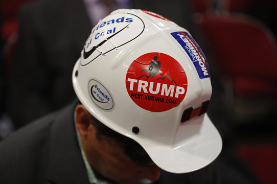 A West Virginia delegate wears a Trump sticker on his hard hat during the second day of the Republican National Convention in Cleveland, Ohio