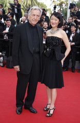 """Director Costa Gavras and French Culture Minister Fleur Pellerin pose on the red carpet as they arrive for the opening ceremony and the screening of the film """"La tete haute"""" out of competition during the 68th Cannes Film Festival in Cannes"""