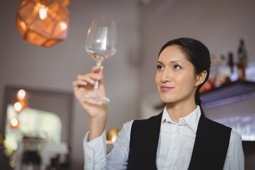 Waitress looking at empty wine glass